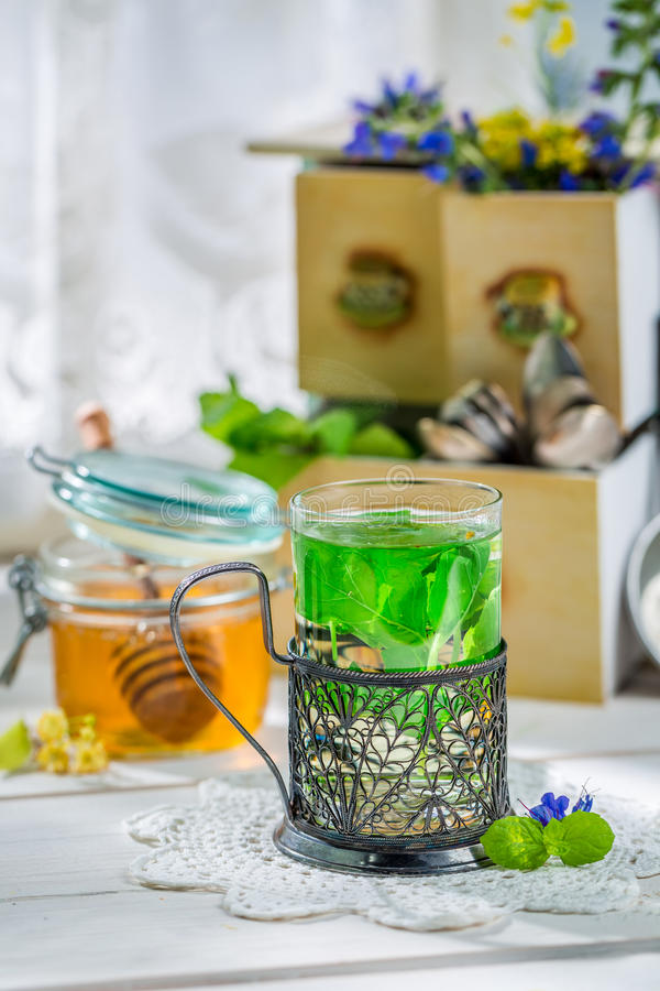 Aromatic mint tea with honey. On old wooden table stock photo