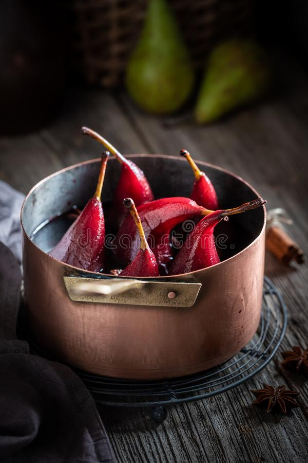 Aromatic mulled wine in basement with demijohn. On wooden table royalty free stock photos