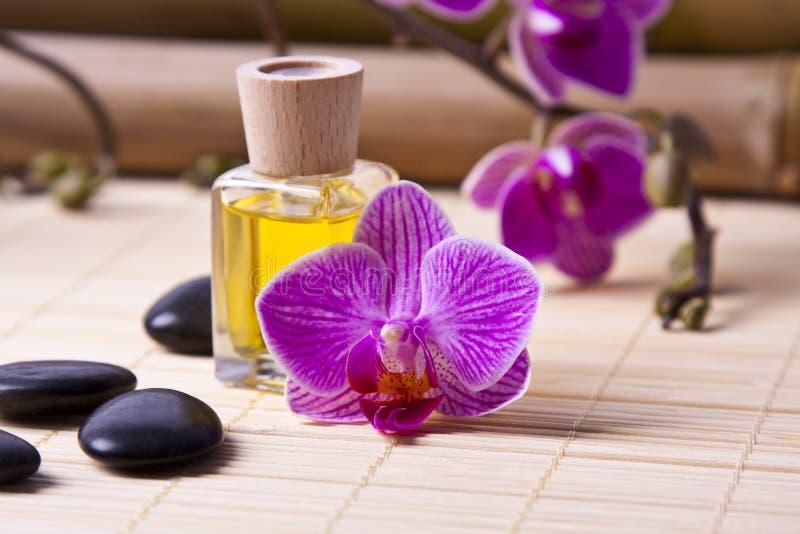 Aromatic oil bottle massage stock photos
