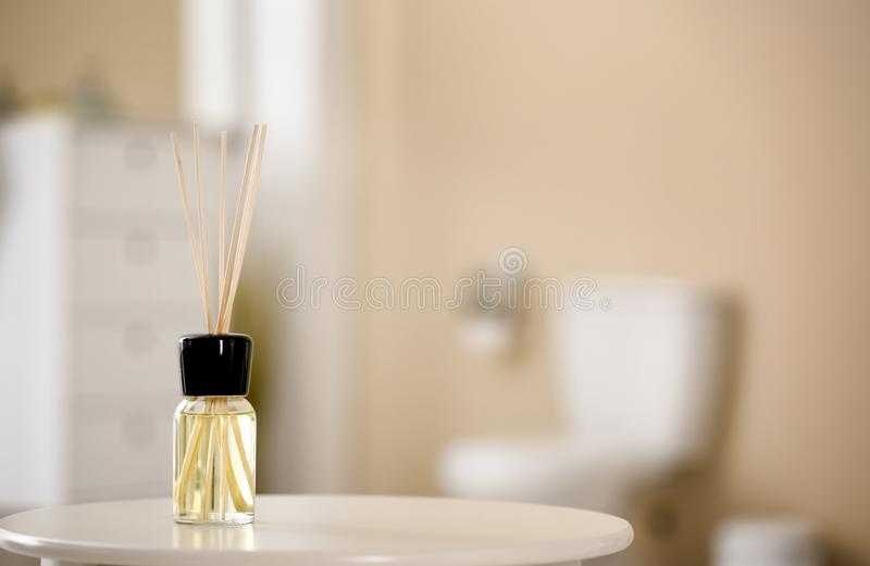 Aromatic reed air freshener on table. Against blurred background stock photo