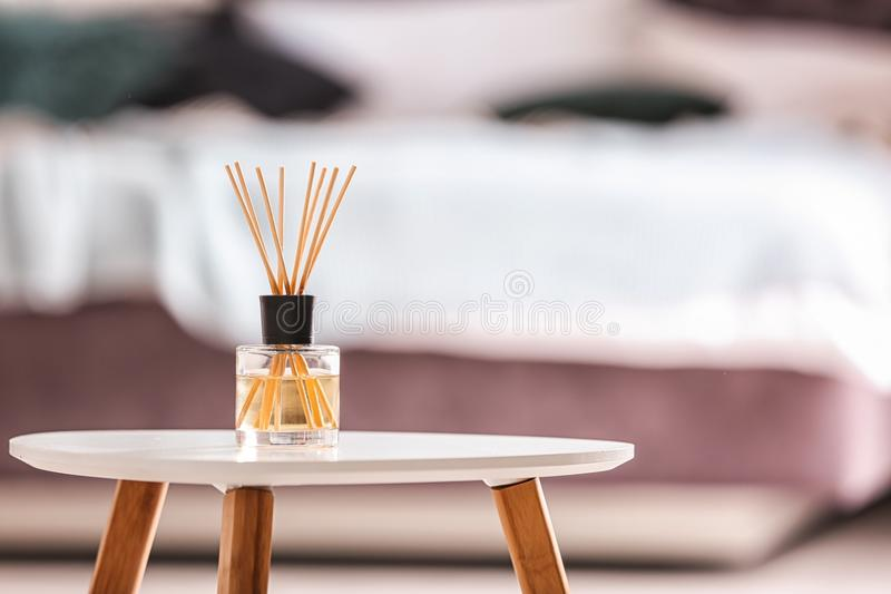 Aromatic reed air freshener on table stock photography