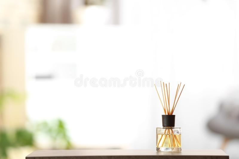 Aromatic reed air freshener on table. Against blurred background stock photos
