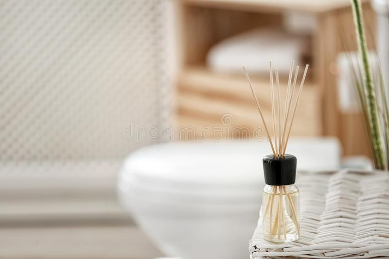 Aromatic reed air freshener on table. Against blurred background stock images