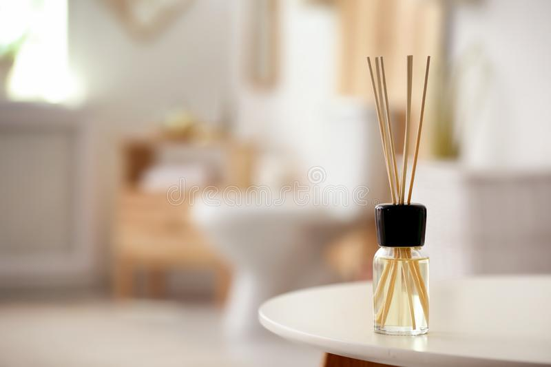 Aromatic reed air freshener on table. Against blurred background stock photography