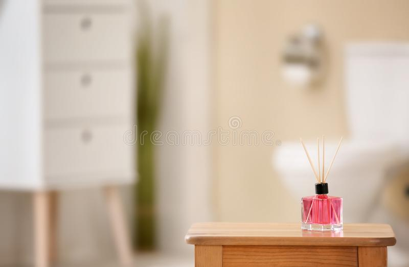 Aromatic reed air freshener on table. Against blurred background royalty free stock photos