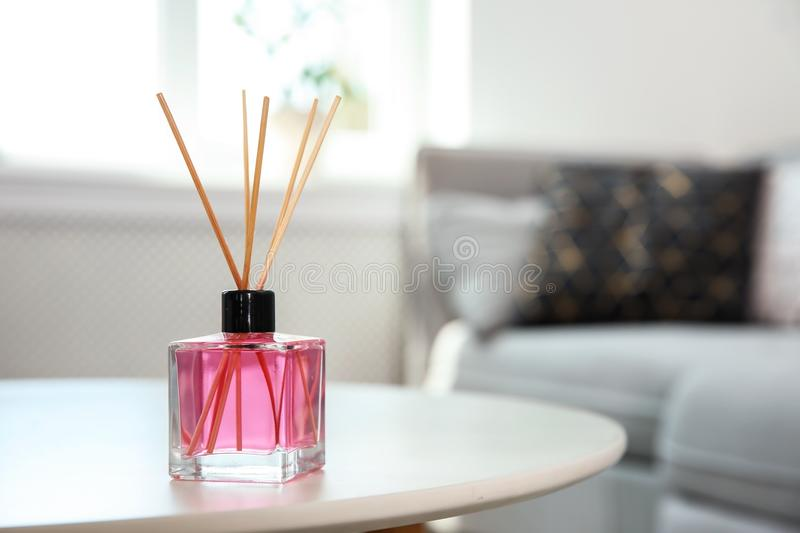 Aromatic reed air freshener on table. Indoors royalty free stock image