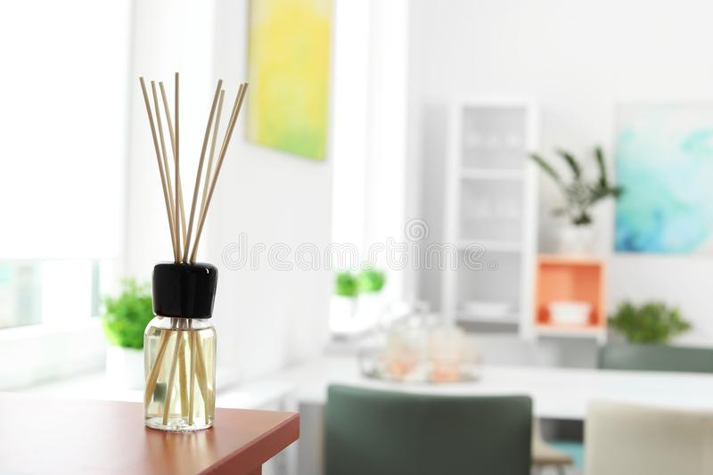 Aromatic reed air freshener on table. In room stock image