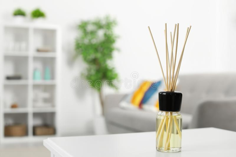 Aromatic reed air freshener on table. In room royalty free stock photos