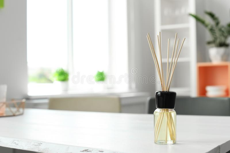Aromatic reed air freshener on table. In room stock photography