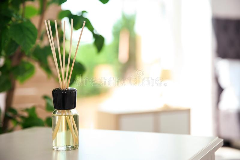 Aromatic reed air freshener on table. Indoors stock image