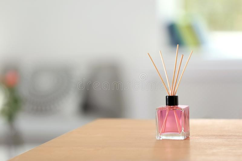 Aromatic reed air freshener on table. Indoors royalty free stock images