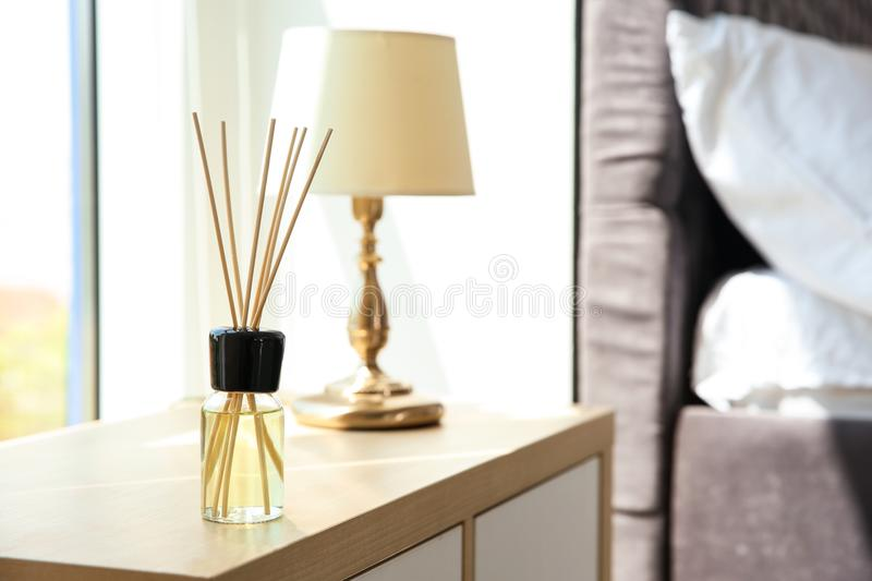 Aromatic reed air freshener on table. Indoors stock photos