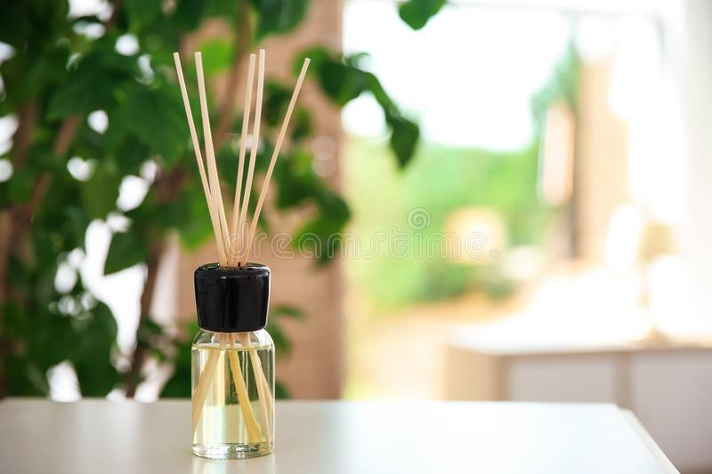 Aromatic reed air freshener on table. Indoors royalty free stock photos
