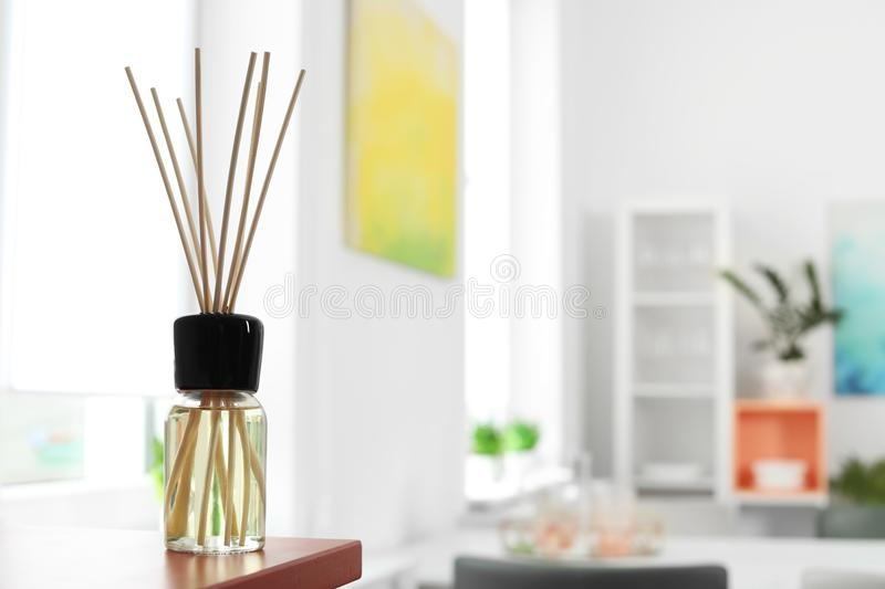 Aromatic reed air freshener on table. In room royalty free stock image