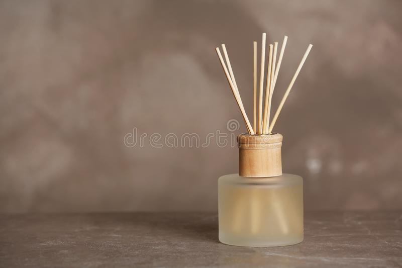 Aromatic reed freshener on table. Against grey background stock images