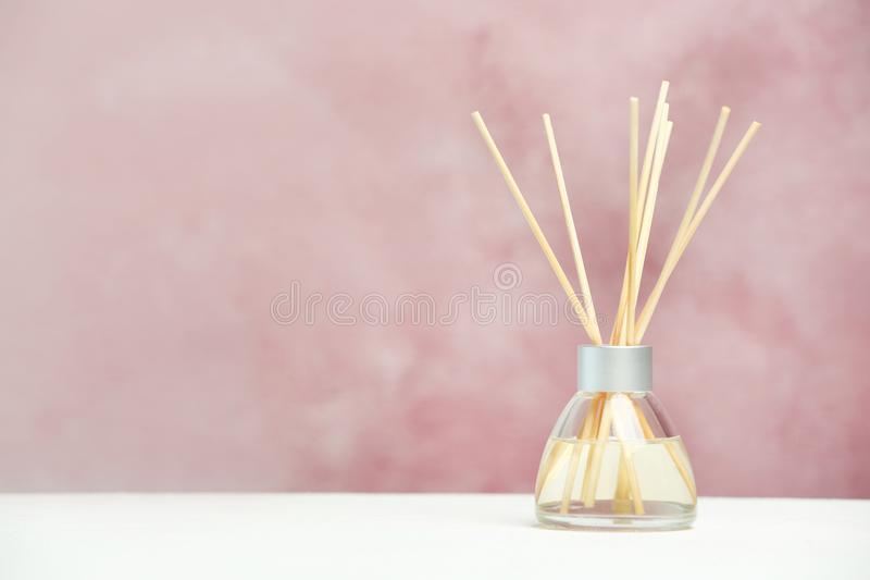 Aromatic reed freshener on table. Against color background royalty free stock photos