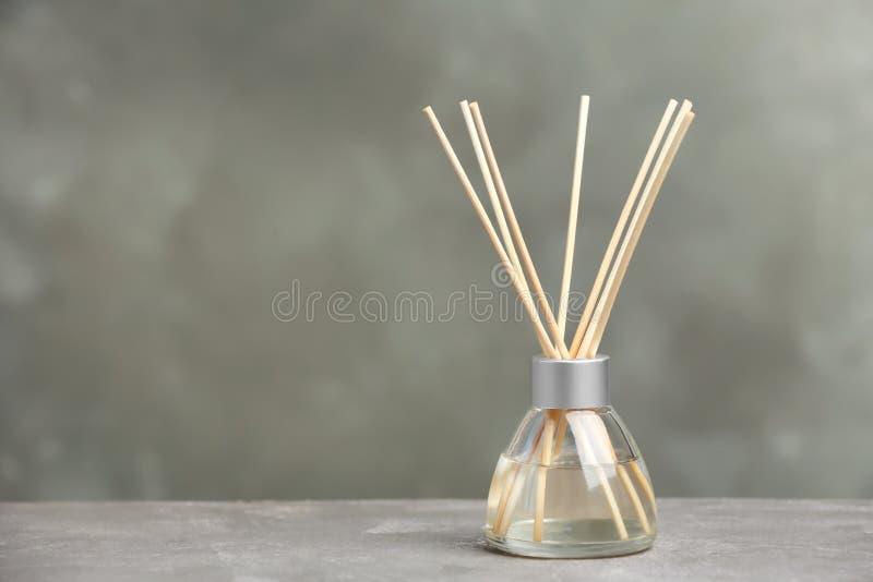 Aromatic reed freshener on table. Against grey background stock photos