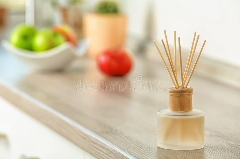 Aromatic reed freshener on table. Indoors stock photography