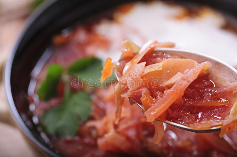 Aromatic soup with sour cream and black bread royalty free stock image