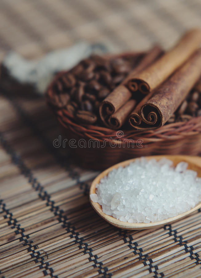 Aromatic spa coffee set with sea salt and cinnamon sticks royalty free stock photos