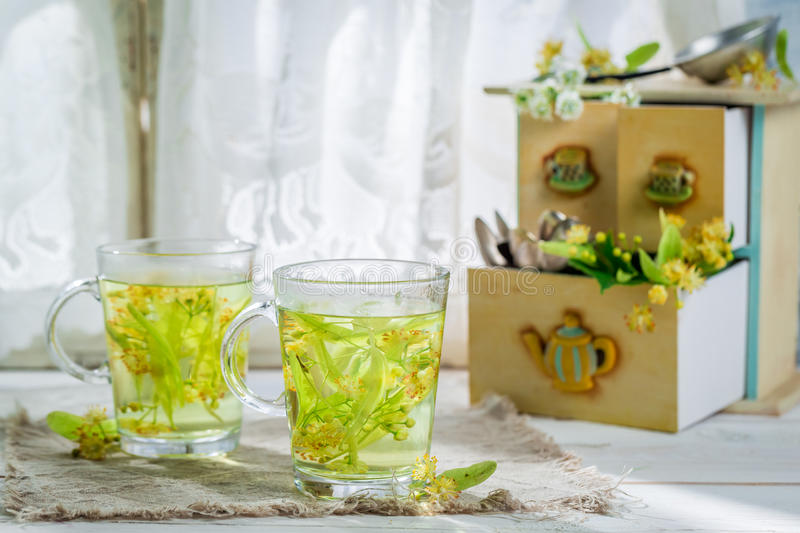 Aromatic tea with honey. On old wooden table royalty free stock image