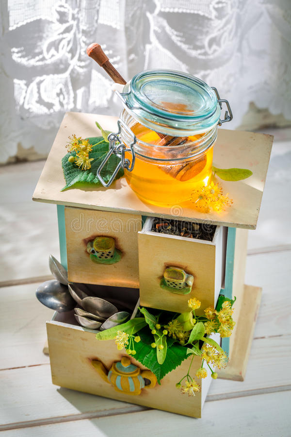 Aromatic tea with honey in sunny day. On old wooden table royalty free stock photo
