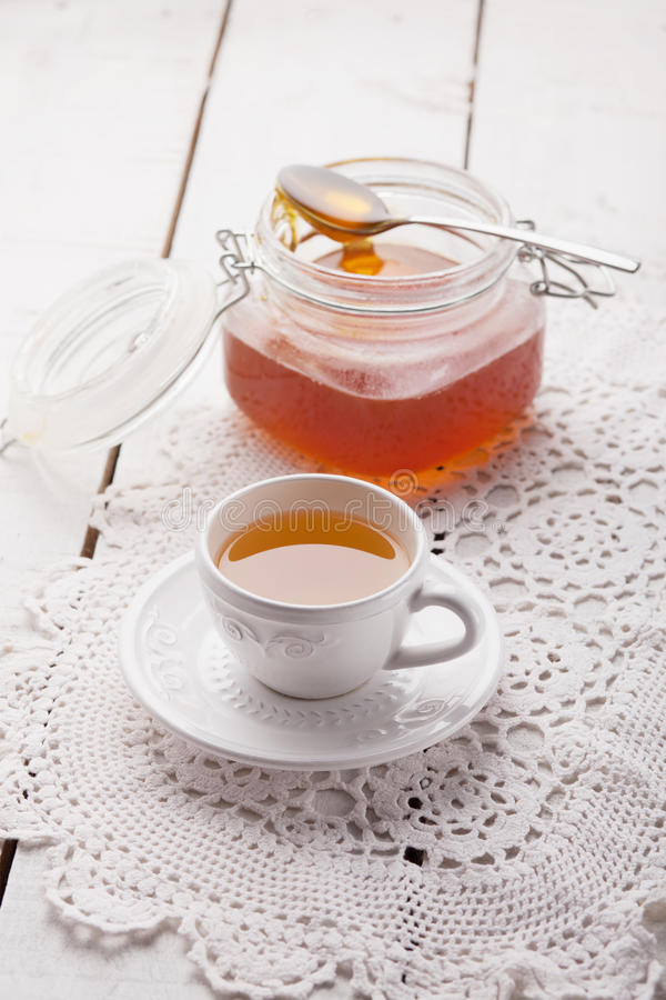 Aromatic tea with honey on wood table. Tea with honey on wood table royalty free stock image