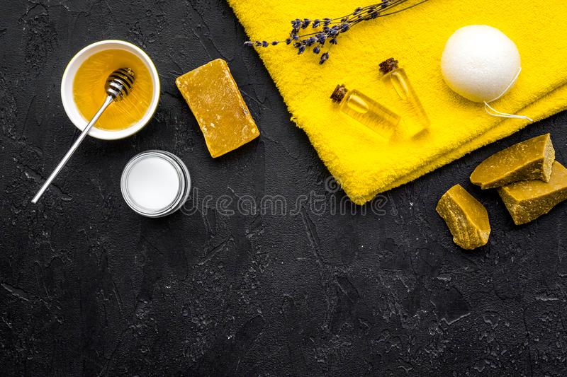 Aromatic theraphy and delicate skin care. Spa set based on honey on black background top view space for text royalty free stock photo
