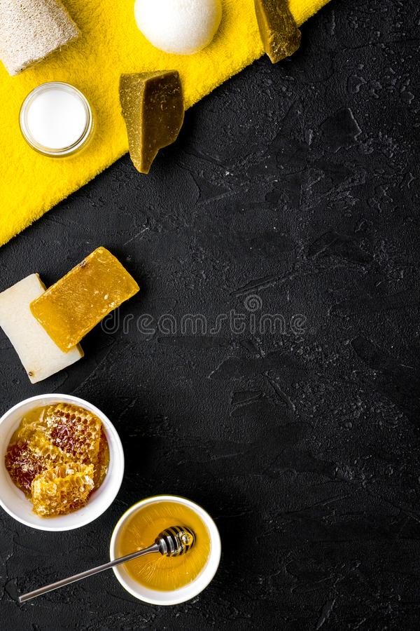 Aromatic theraphy and delicate skin care. Spa set based on honey on black background top view space for text stock photo