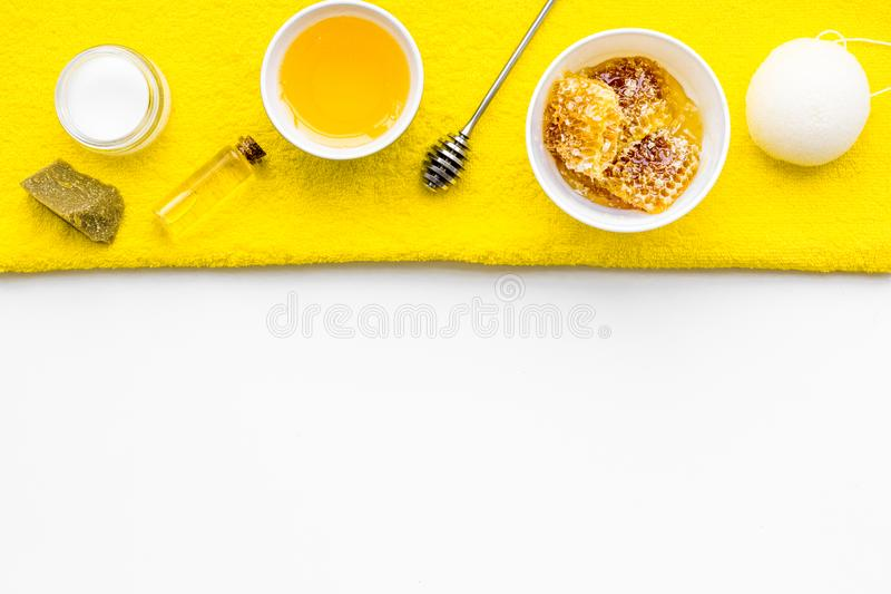 Aromatic theraphy and delicate skin care. Spa set based on honey on white background top view copy space stock photos