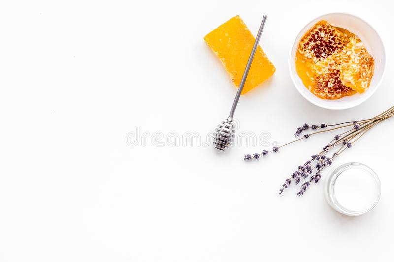 Aromatic theraphy and delicate skin care. Spa set based on honey on white background top view copy space stock image