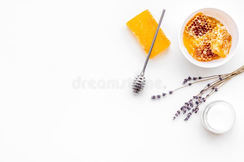 Aromatic theraphy and delicate skin care. Spa set based on honey on white background top view copy space royalty free stock images