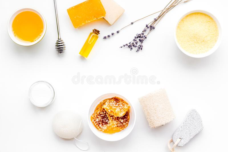Aromatic theraphy and delicate skin care. Spa set based on honey on white background top view copy space royalty free stock photos