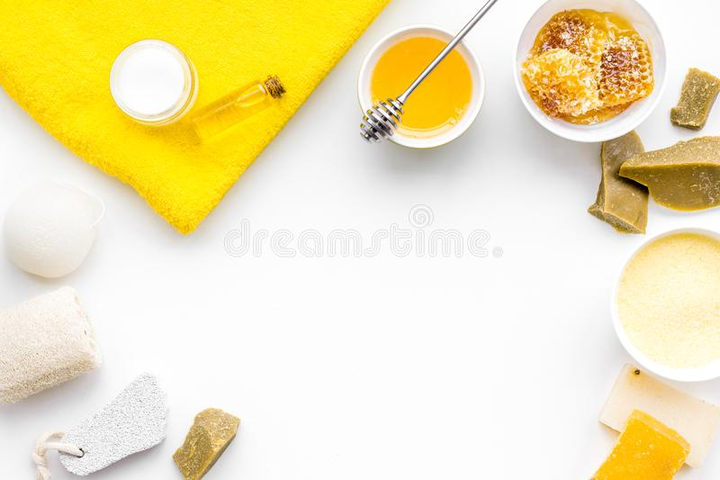 Aromatic theraphy and delicate skin care. Spa set based on honey on white background top view copy space stock images