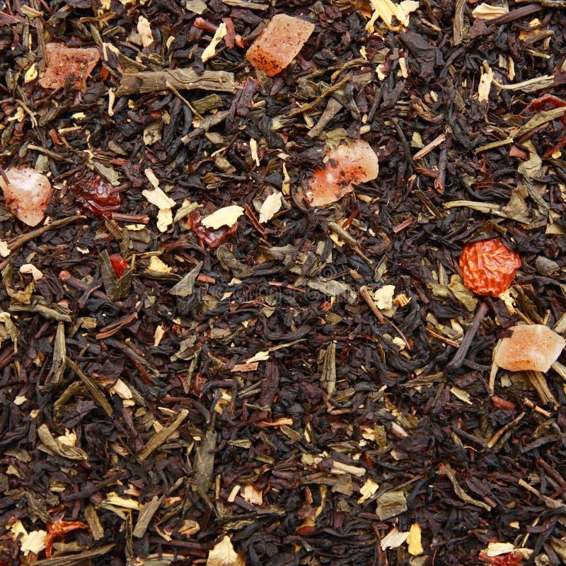 Aromatische thee met vruchten en bloemen. royalty-vrije stock afbeeldingen