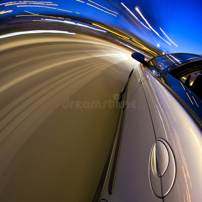 Around the bend. A car driving at high speed through a curved section of the motorway stock image