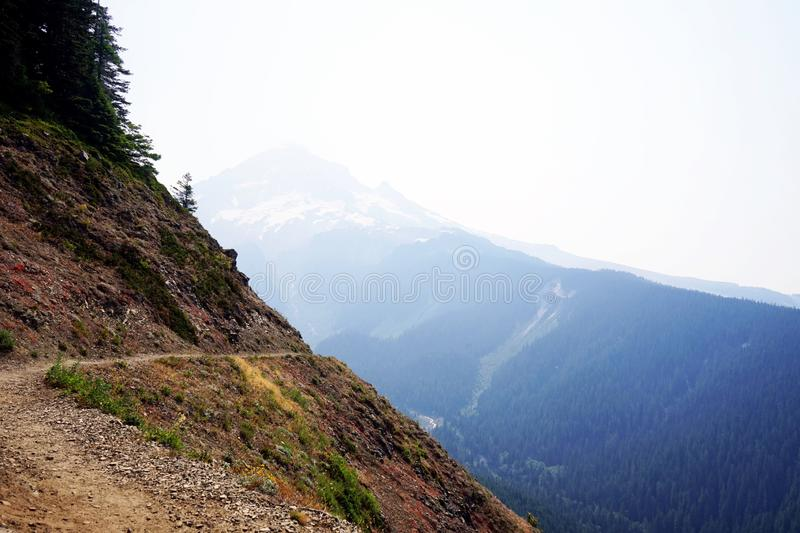 Around the corner. Mountain mthood trail hiking hike nopeople view adventure outdoors Oregon hazy horizontal royalty free stock photography