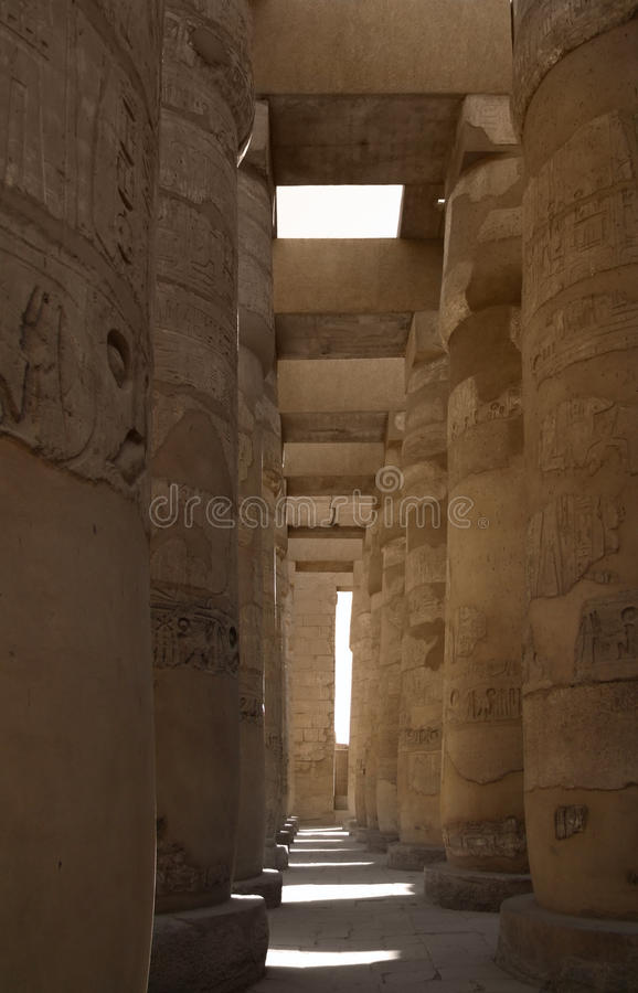 Around Precinct of Amun-Re in Egypt. Ancient mystic scenery around Precinct of Amun-Re in Egypt with huge stone columns royalty free stock images