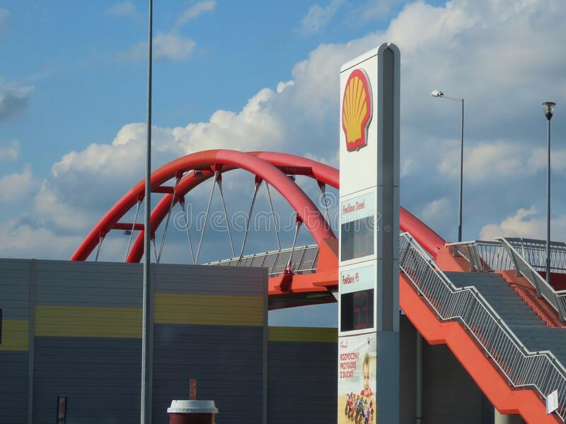 Shell gas station, red bridge. Around Warsaw, Poland - September 10, 2019. Shell gas station sign and red pedestrian bridge by motorway A2 heading into Warsaw royalty free stock photo