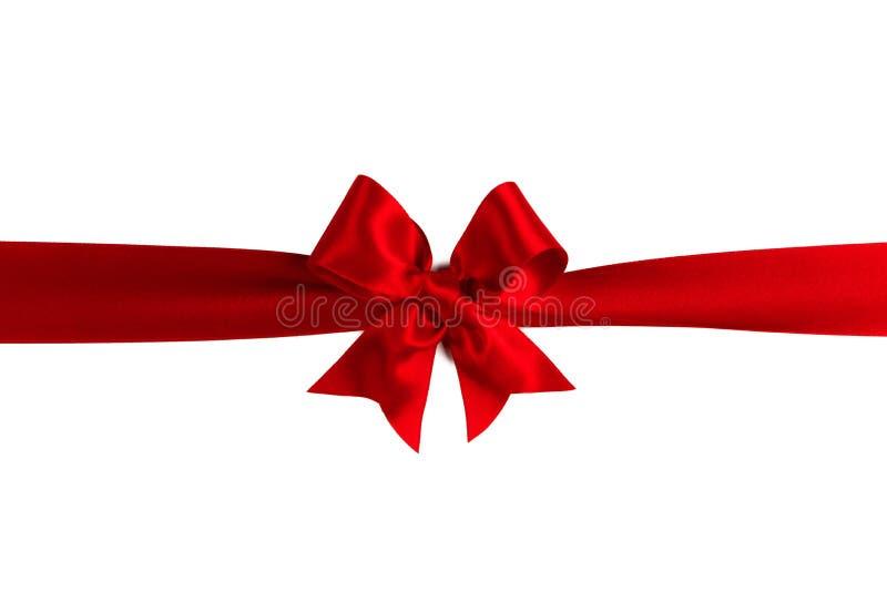 Arqueamiento rojo del regalo en blanco imagen de archivo libre de regalías