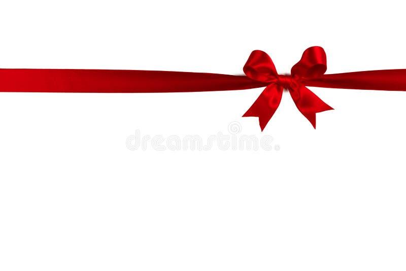 Arqueamiento rojo del regalo en blanco imagenes de archivo