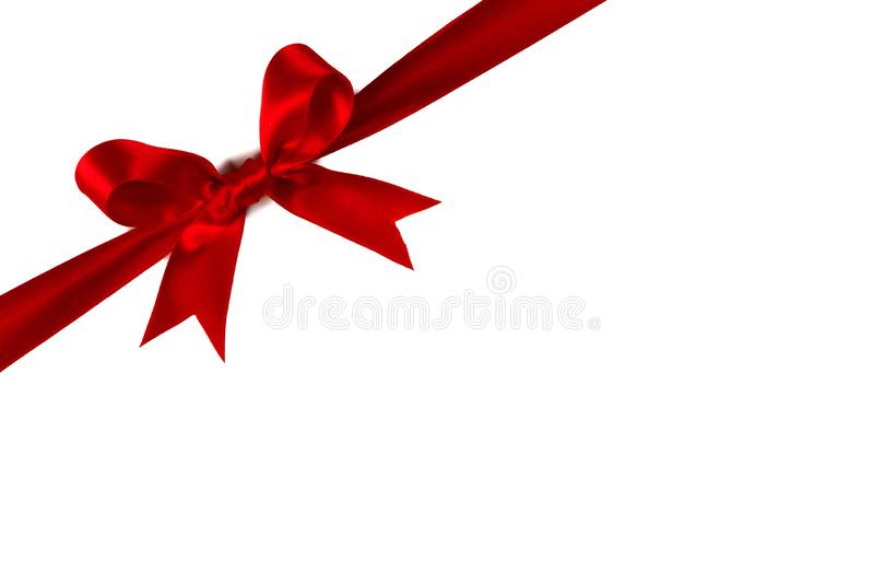 Arqueamiento rojo del regalo en blanco foto de archivo libre de regalías