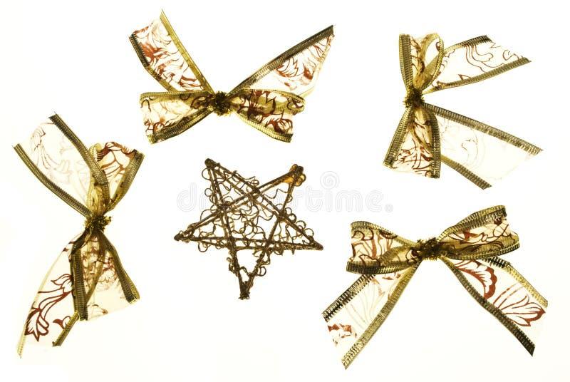 Arqueamientos y estrella del oro de la Navidad fotografía de archivo