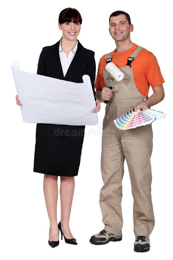 Arquitecto del pintor y de la mujer foto de archivo libre de regalías