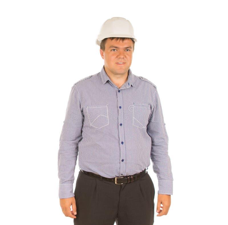Arquitecto joven que presenta en su casco de protección fotos de archivo