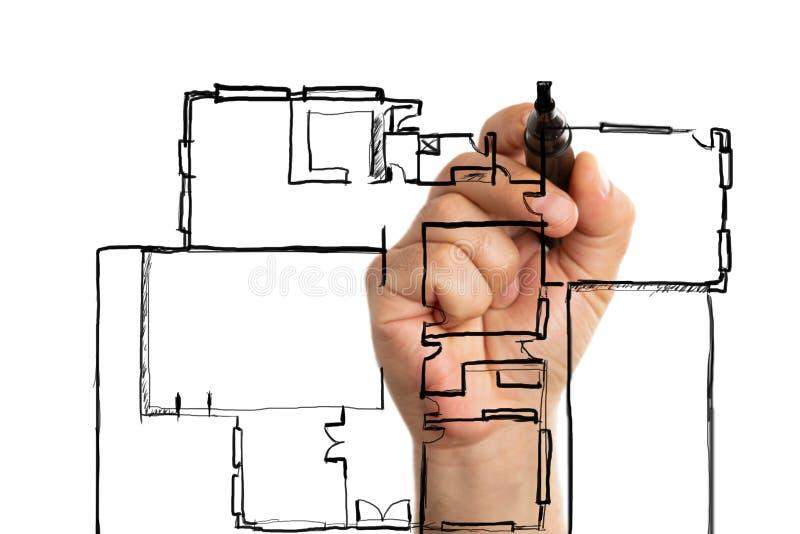 Arquitecto que hace plan de la casa imágenes de archivo libres de regalías