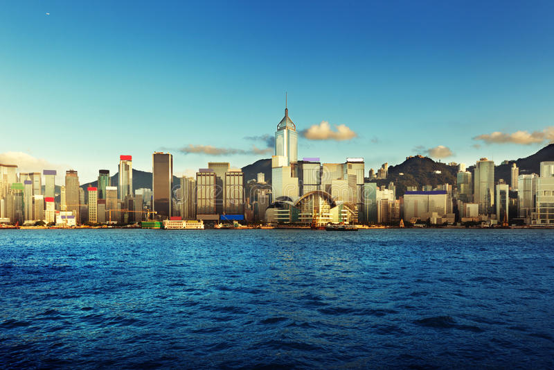 Arquitectura da cidade de Hong Kong no por do sol fotos de stock royalty free