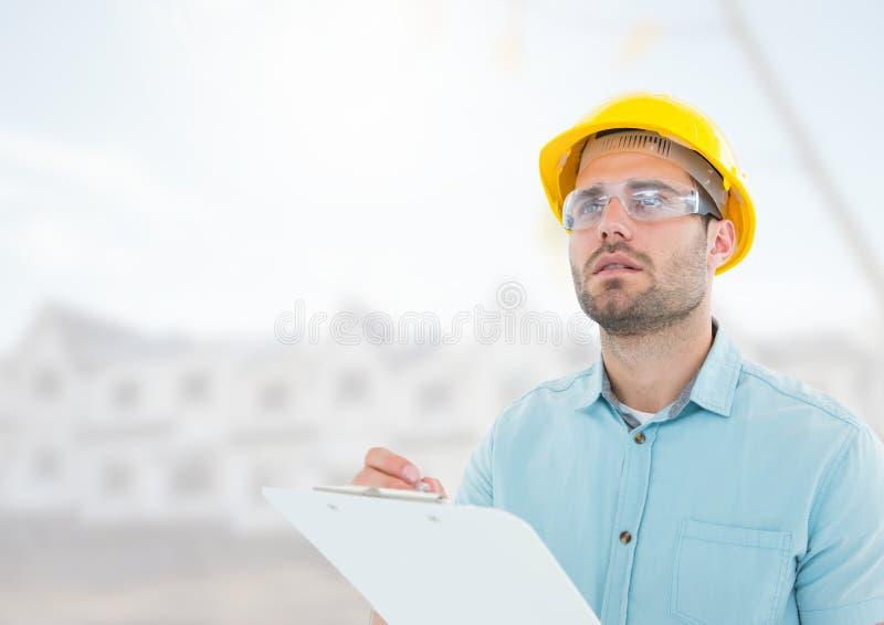 Arquiteto com os modelos no terreno de construção fotos de stock