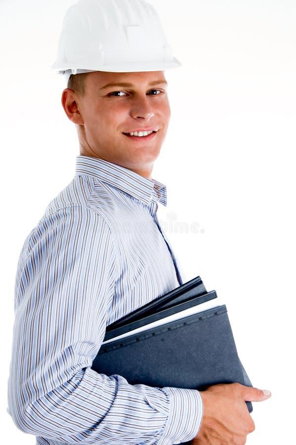 Arquiteto de sorriso com arquivos foto de stock