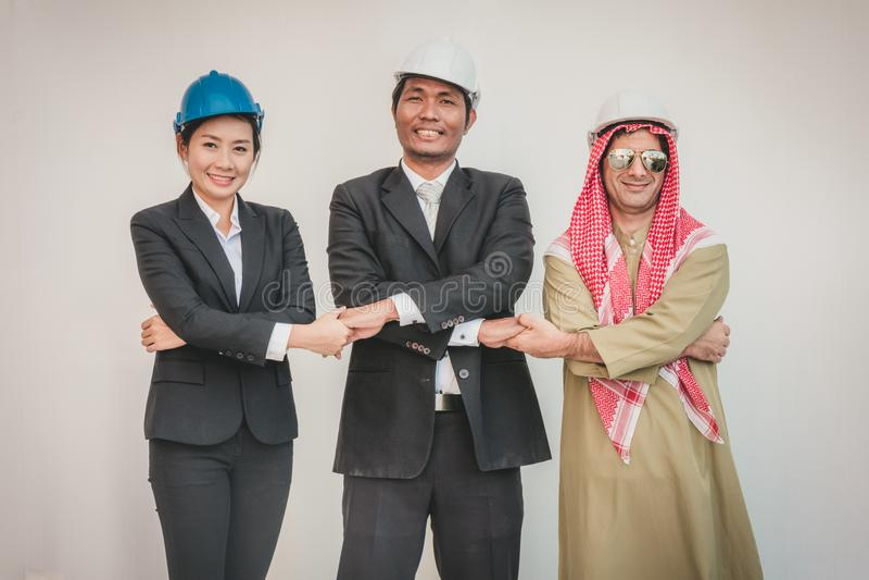 Arquiteto e trabalhador do coordenador de construção da equipe do negócio teamwork fotografia de stock